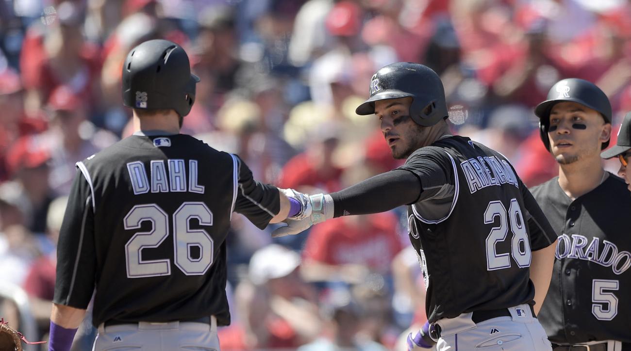 Colorado Rockies' Nolan Arenado (28) celebrates his two-run home run with David Dahl (26) and Carlos Gonzalez (5) during the third inning of a baseball game against the Washington Nationals, Sunday, Aug. 28, 2016, in Washington. (AP Photo/Nick Wass)
