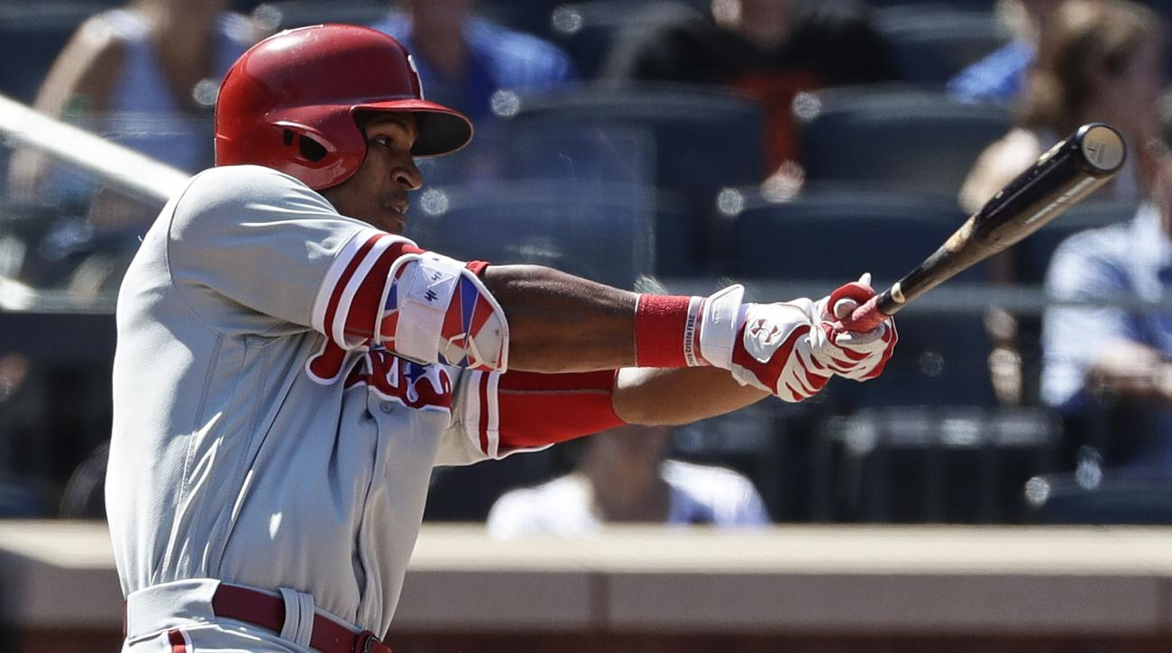 Philadelphia Phillies' Jimmy Paredes hits an RBI-double during the fourth inning of a baseball game against the New York Mets, Sunday, Aug. 28, 2016, in New York. (AP Photo/Frank Franklin II)