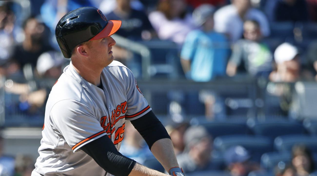 Baltimore Orioles designated hitter Mark Trumbo watches his eighth-inning, two-run, home run off New York Yankees relief pitcher Ben Heller in a baseball game in New York, Sunday, Aug. 28, 2016. (AP Photo/Kathy Willens)