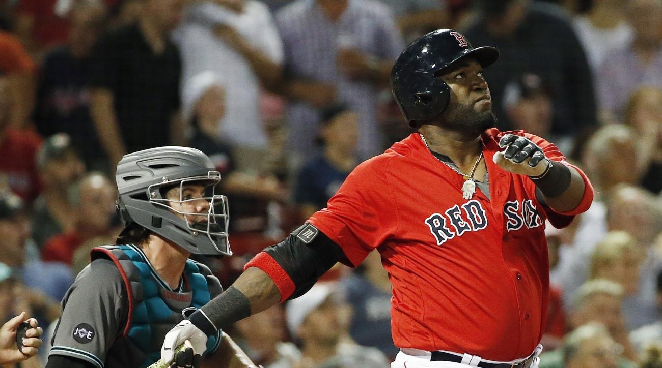 FILE - In this Aug. 12, 2016, file photo, Boston Red Sox's David Ortiz, right, watches his solo home run in front of Arizona Diamondbacks' Tuffy Gosewisch during the seventh inning of a baseball game in Boston. It seems like everybody wants their chance t