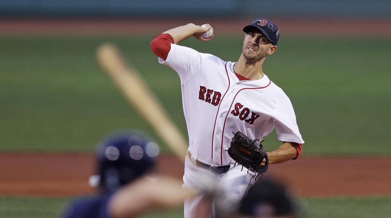 Boston Red Sox starting pitcher Rick Porcello delivers against the Tampa Bay Rays during the first inning of a baseball game at Fenway Park, Monday, Aug. 29, 2016, in Boston. (AP Photo/Charles Krupa)