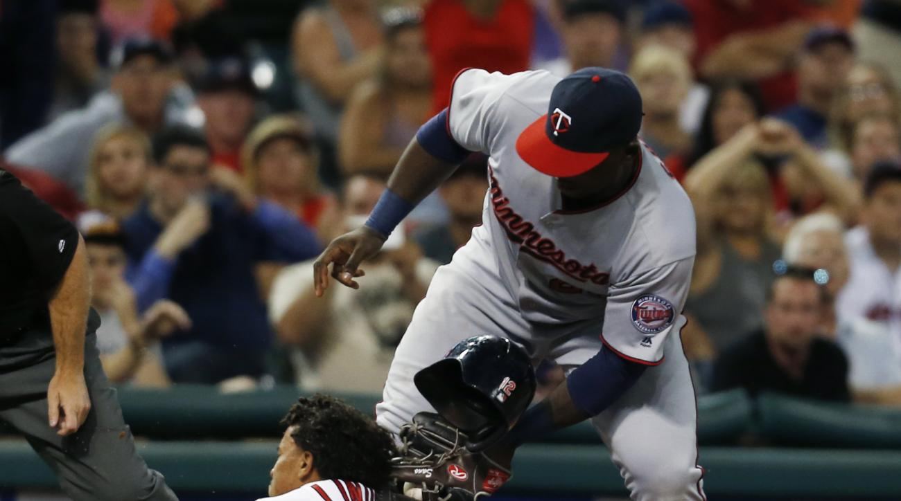 Cleveland Indians' Francisco Lindor (12) is tagged out at third base by Minnesota Twins' Miguel Sano (22) trying to advance on a hit by Mike Napoli during the eighth inning of a baseball game, Monday, Aug. 29, 2016, in Cleveland. (AP Photo/Ron Schwane)