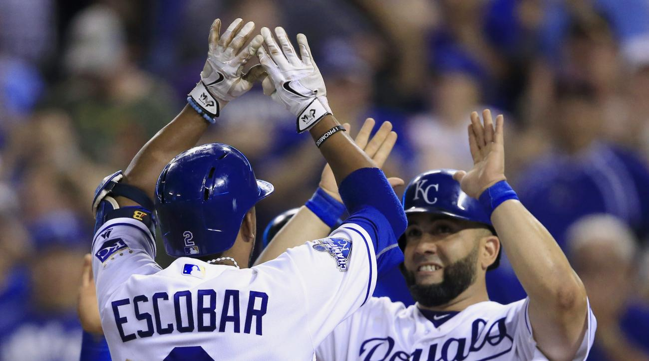 Kansas City Royals' Alcides Escobar (2) celebrates his three-run home run with teammate Kendrys Morales (25) during the seventh inning of a baseball game against the New York Yankees at Kauffman Stadium in Kansas City, Mo., Monday, Aug. 29, 2016. (AP Phot