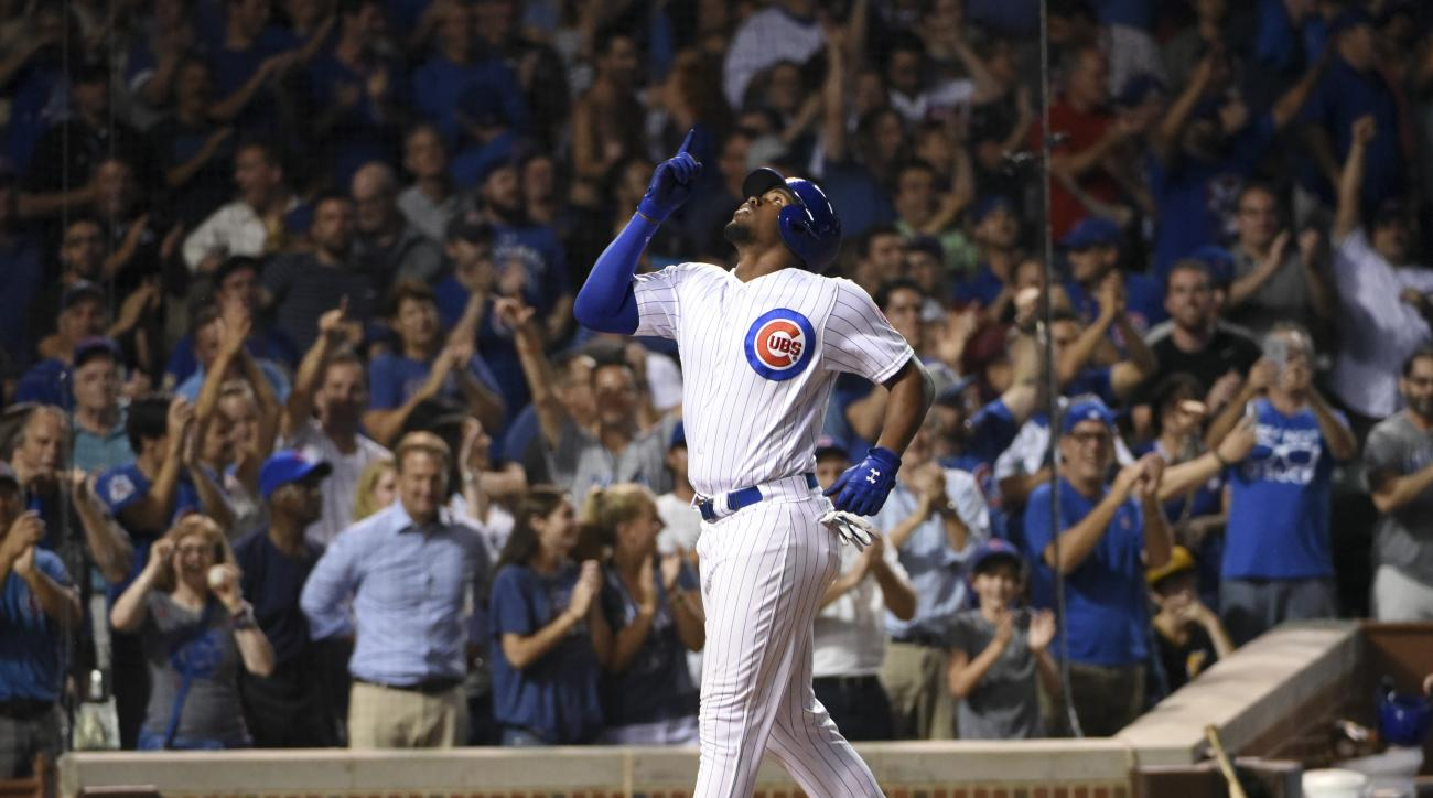 Chicago Cubs' Jorge Soler (68) reacts after crossing home plate after hitting his solo home run against the Pittsburgh Pirates during the ninth inning of a baseball game, Monday, Aug. 29, 2016, in Chicago. (AP Photo/David Banks)