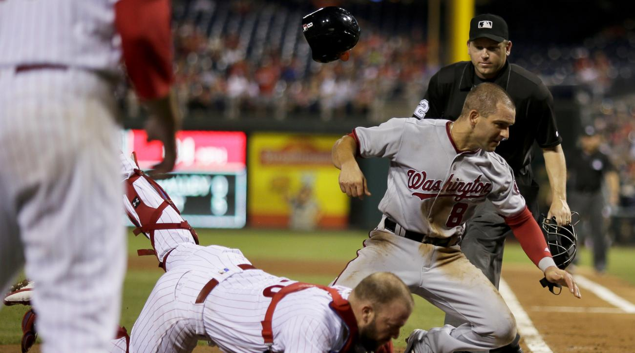 Washington Nationals' Danny Espinosa (8) collides with Philadelphia Phillies catcher Cameron Rupp after being tagged out trying to score on a single by Trea Turner during the fourth inning of a baseball game, Tuesday, Aug. 30, 2016, in Philadelphia. (AP P