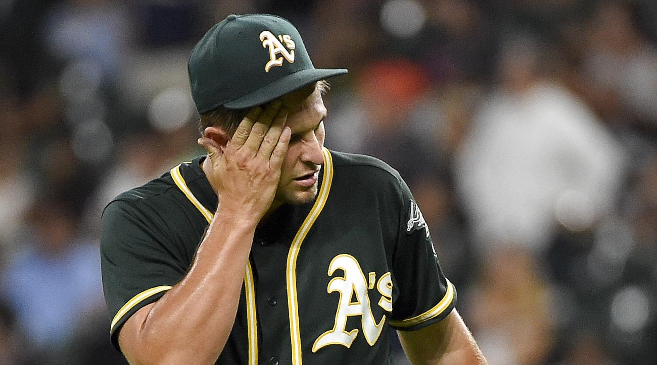 Oakland Athletics starting pitcher Kendall Graveman reacts after giving up a solo home run to Houston Astros' Evan Gattis during the seventh inning of a baseball game Tuesday, Aug. 30, 2016, in Houston. (AP Photo/Eric Christian Smith)
