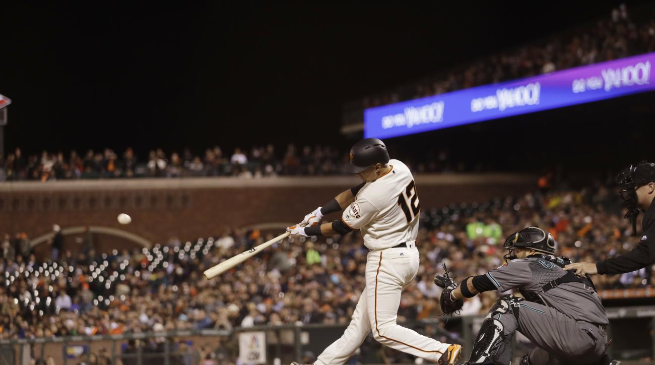 San Francisco Giants' Joe Panik drives in a run with a double against the Arizona Diamondbacks during the sixth inning of a baseball game Tuesday, Aug. 30, 2016, in San Francisco. (AP Photo/Marcio Jose Sanchez)
