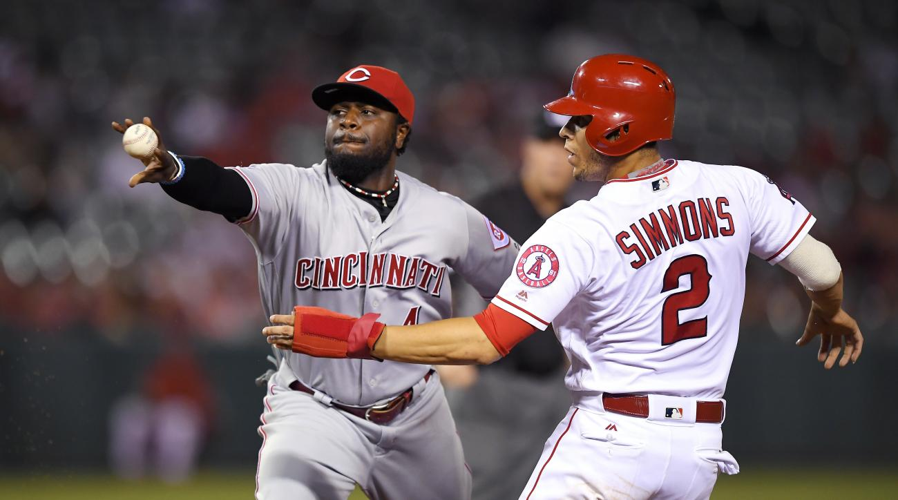 Cincinnati Reds second baseman Brandon Phillips, left, throws out Los Angeles Angels' Kaleb Cowart at first after tagging out Andrelton Simmons between first and second during the eighth inning of a baseball game, Tuesday, Aug. 30, 2016, in Anaheim, Calif
