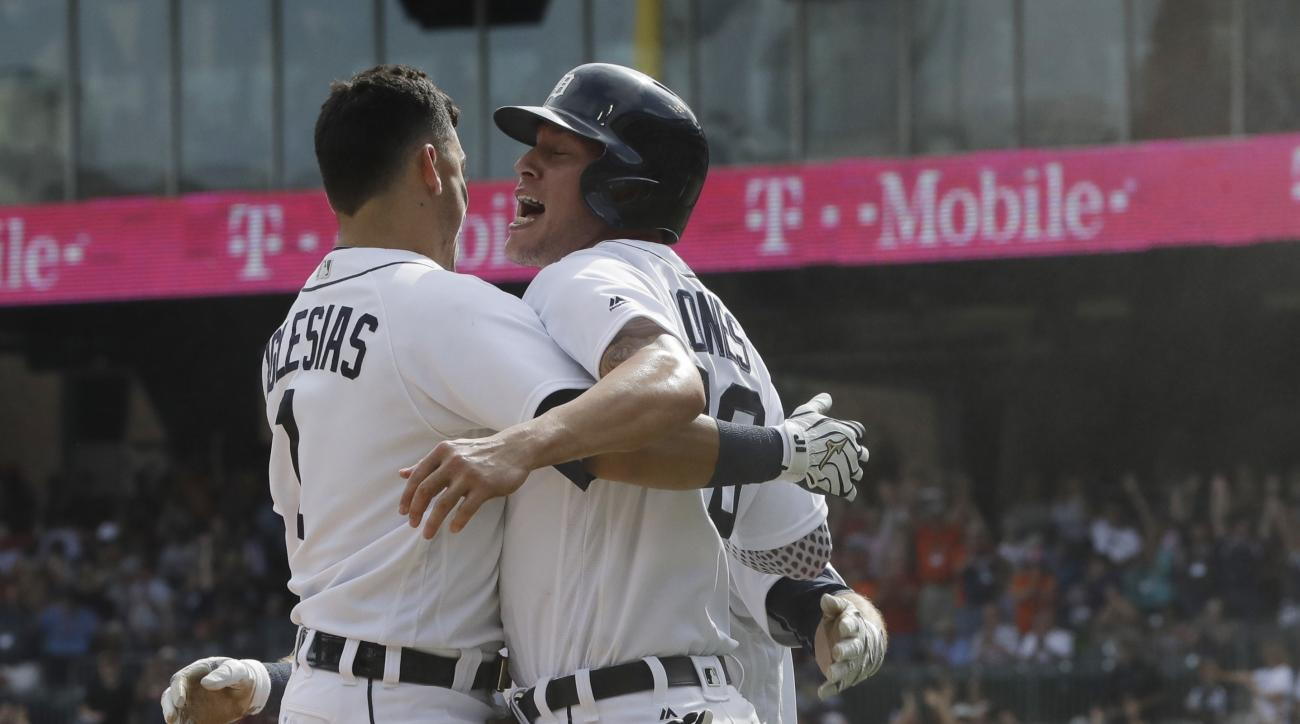 Detroit Tigers' JaCoby Jones, right, is greeted by teammate Jose Iglesias, after scoring the game-winning run during the ninth inning of a baseball game against the Chicago White Sox, Wednesday, Aug. 31, 2016, in Detroit. The Tigers won 3-2. (AP Photo/Car