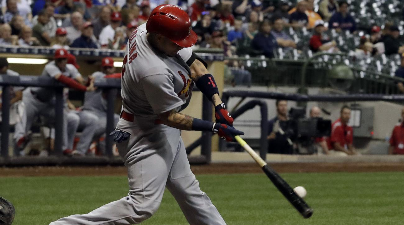 St. Louis Cardinals' Yadier Molina hits a home run during the fourth inning of a baseball game against the Milwaukee Brewers Wednesday, Aug. 31, 2016, in Milwaukee. (AP Photo/Morry Gash)