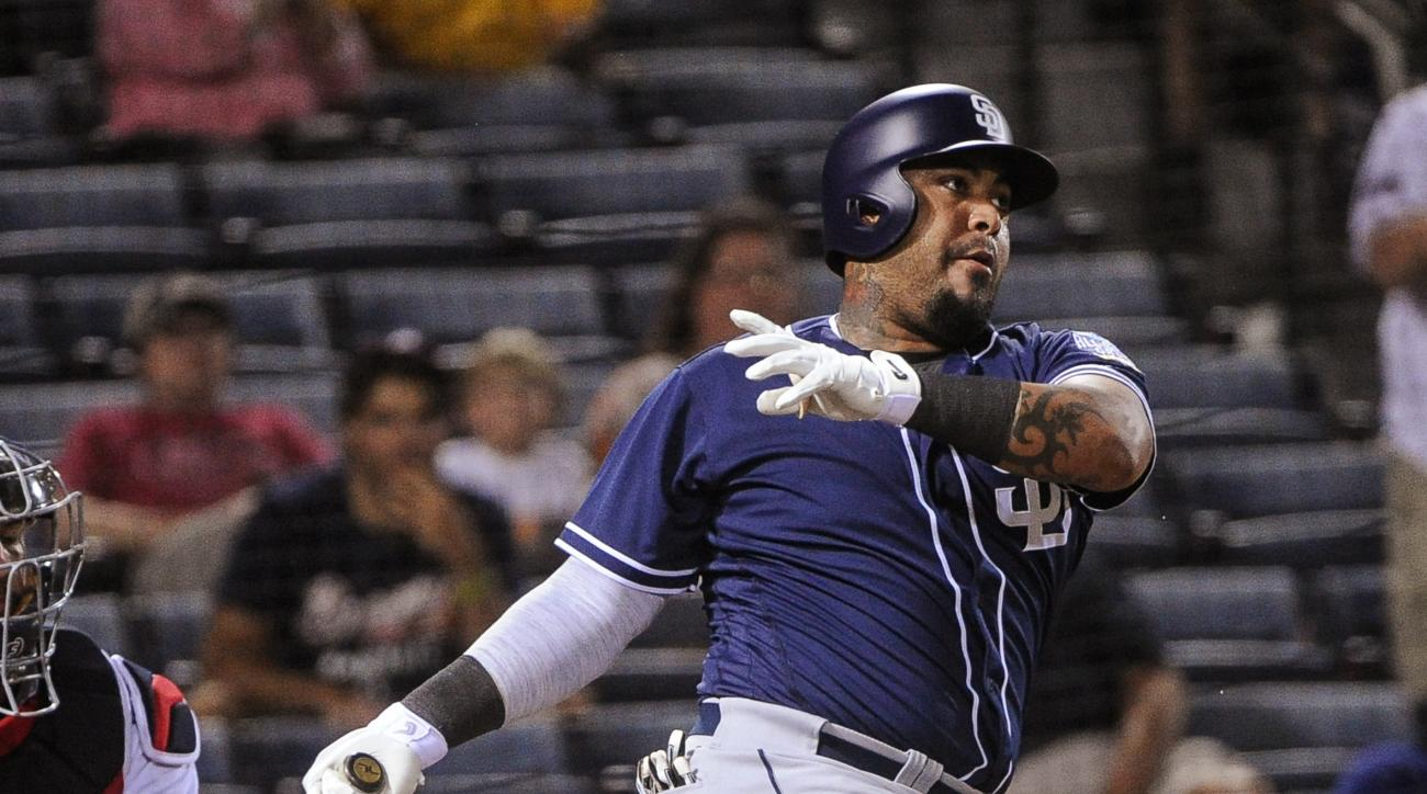 San Diego Padres' Hector Sanchez strikes out end a baseball against the Atlanta Braves, Wednesday, Aug. 31, 2016, in Atlanta. (AP Photo/John Amis)
