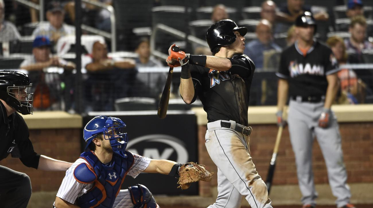 Miami Marlins Christian Yelich hits a two-run home run off of New York Mets reliever Josh Smoker as Travis d'Arnaud catches for the Mets in the seventh inning of a baseball game, Thursday, Sept. 1, 2016, in New York. (AP Photo/Kathy Kmonicek)