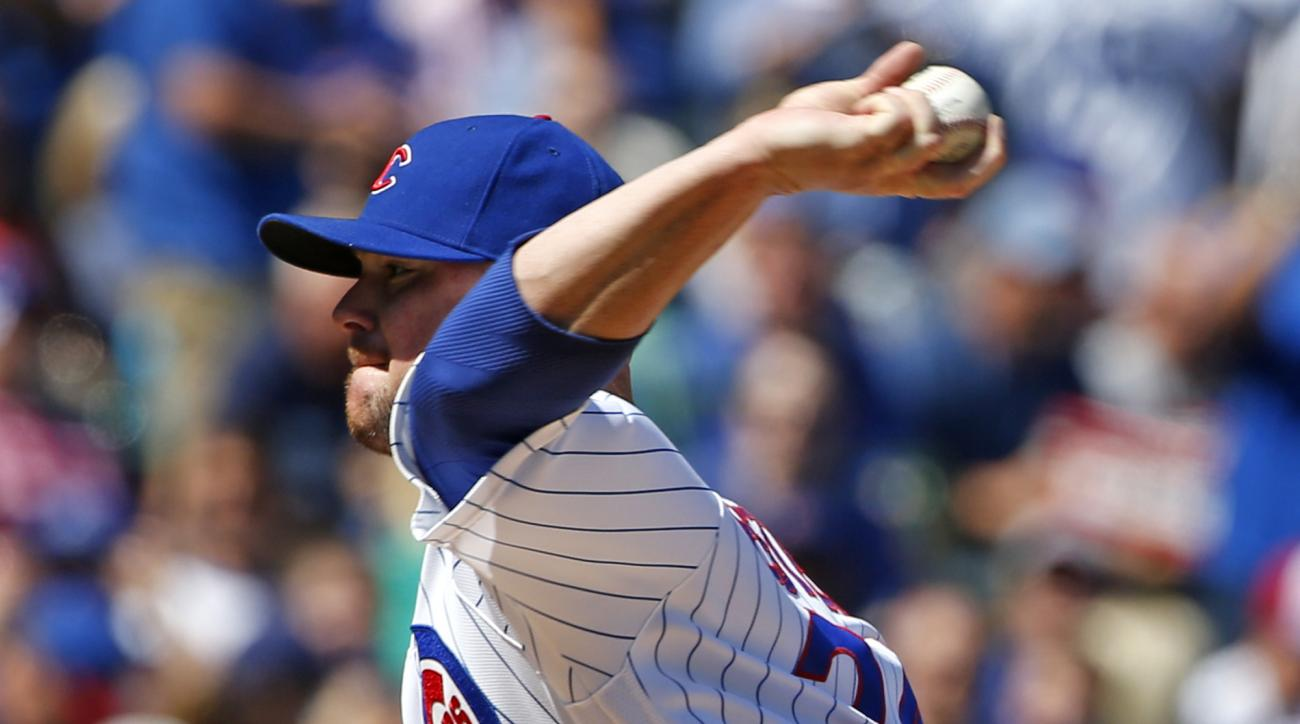 Chicago Cubs starter Jon Lester throws against the San Francisco Giants during the first inning of a baseball game Friday, Sept. 2, 2016, in Chicago. (AP Photo/Nam Y. Huh)