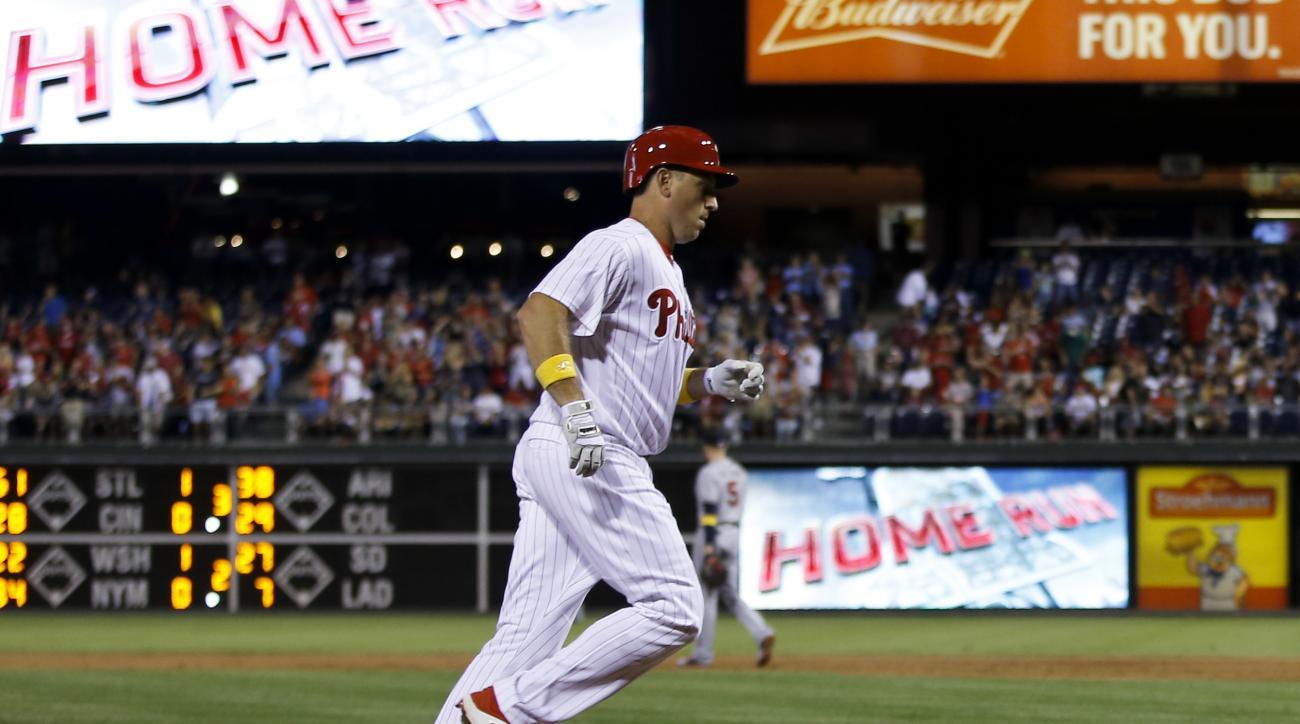 Philadelphia Phillies' A.J. Ellis rounds the bases after hitting a three-run home run off Atlanta Braves starting pitcher Joel De La Cruz during the second inning of a baseball game, Friday, Sept. 2, 2016, in Philadelphia. (AP Photo/Dake Kang)
