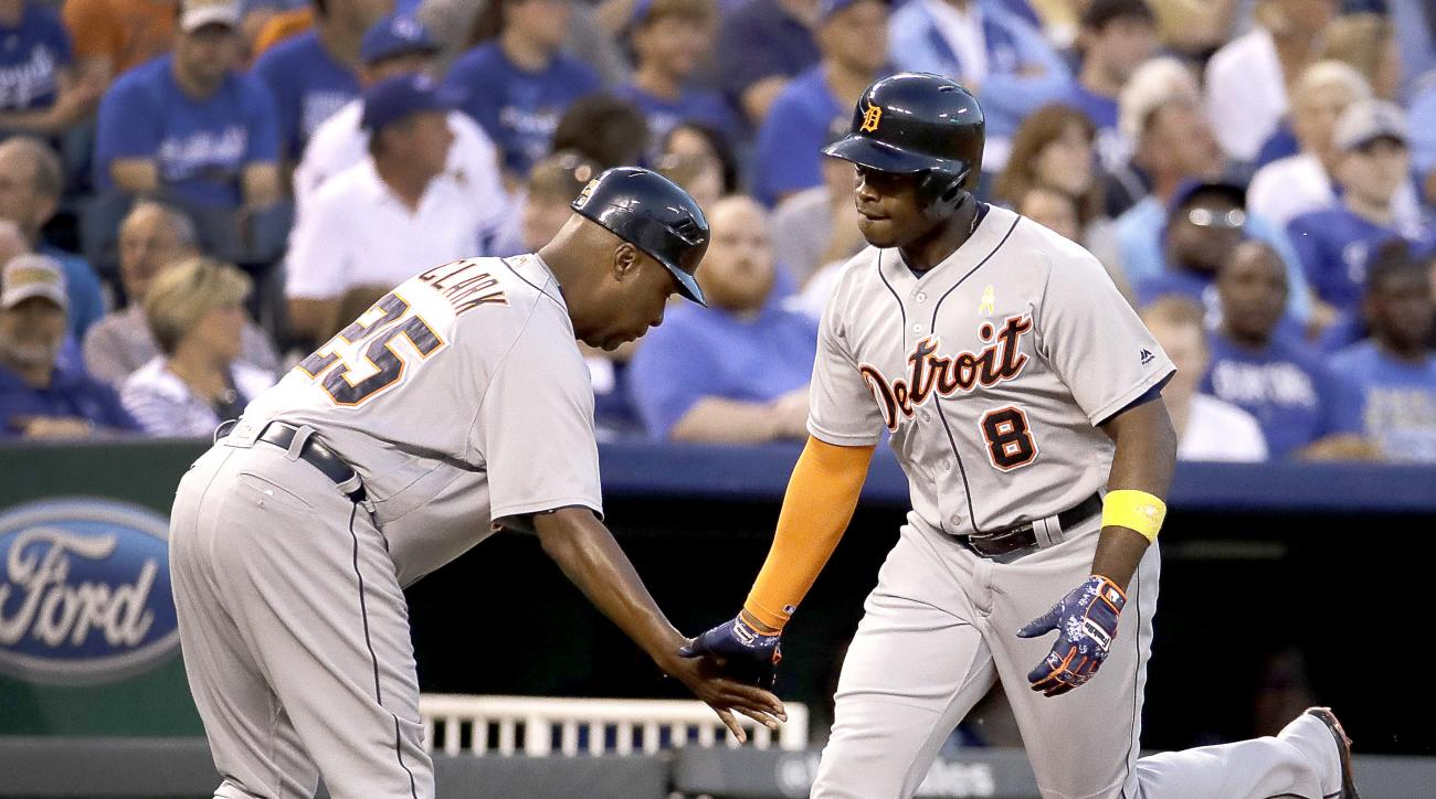 Detroit Tigers' Justin Upton (8) celebrates with third base coach Dave Clark after hitting a solo home run during the second inning of a baseball game against the Kansas City Royals on Friday, Sept. 2, 2016, in Kansas City, Mo. (AP Photo/Charlie Riedel)