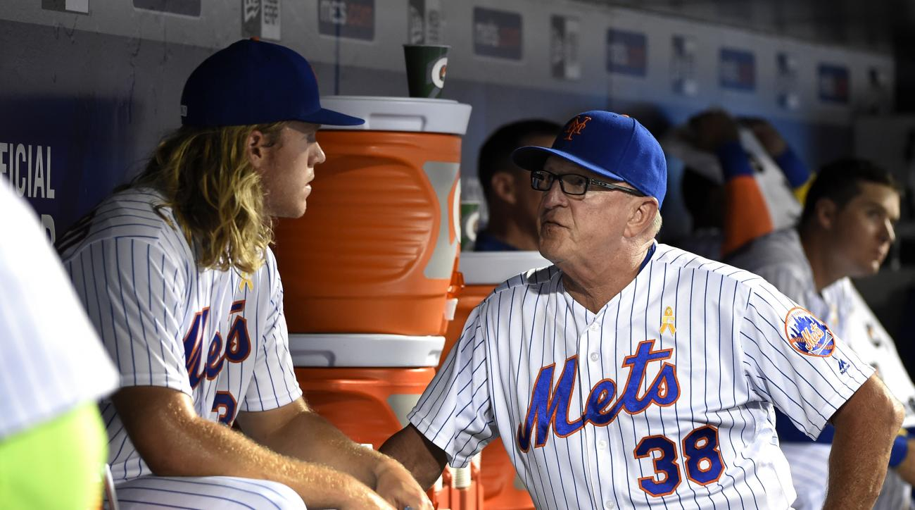 New York Mets pitching coach Dan Warthen (38) talks with starting pitcher Noah Syndergaard in the dugout in the fourth inning of a baseball game against the Washington Nationals, Friday, Sept. 2, 2016, in New York. (AP Photo/Kathy Kmonicek)