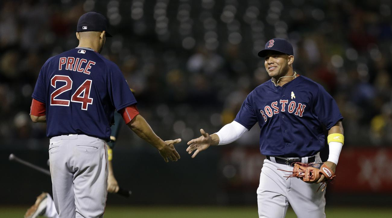 Boston Red Sox's Yoan Moncada, right, is congratulated by David Price at the end of the seventh inning of a baseball game against the Oakland Athletics on Friday, Sept. 2, 2016, in Oakland, Calif. (AP Photo/Ben Margot)