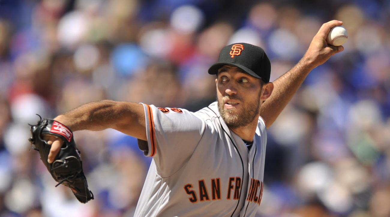 San Francisco Giants starter Madison Bumgarner pitches during the first inning of a baseball game against the Chicago Cubs, Saturday, Sept. 3, 2016, in Chicago. (AP Photo/Paul Beaty)