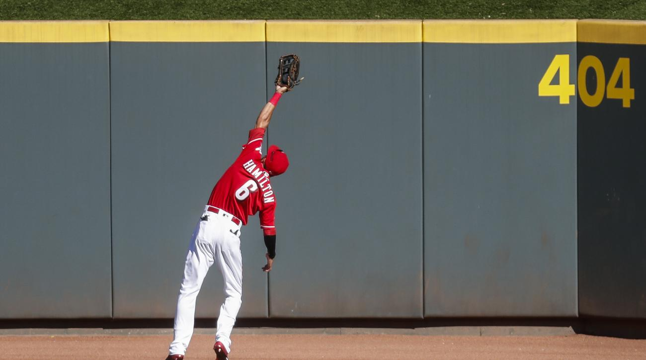 Cincinnati Reds center fielder Billy Hamilton catches the ball hit by St. Louis Cardinals' Alberto Rosario in the fourth inning of a baseball game, Saturday, Sept. 3, 2016, in Cincinnati. (AP Photo/John Minchillo)