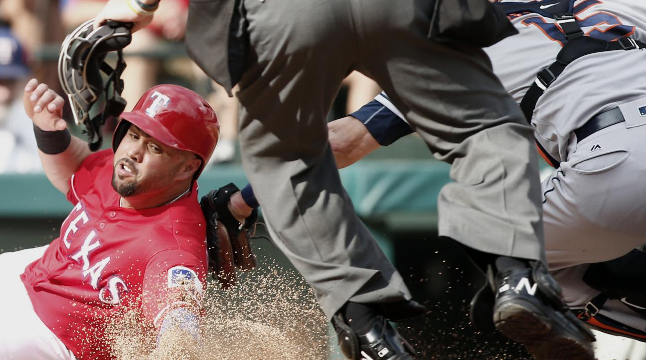 CORRECTS TO RANGERS' CARLOS BELTRAN NOT CARLOS GOMEZ - Texas Rangers' Carlos Beltran, left, is tagged out by Houston Astros catcher Jason Castro (15) in the fifth inning of a baseball game Saturday, Sep. 3, 2016, in Arlington, Texas. (AP Photo/Mike Stone)