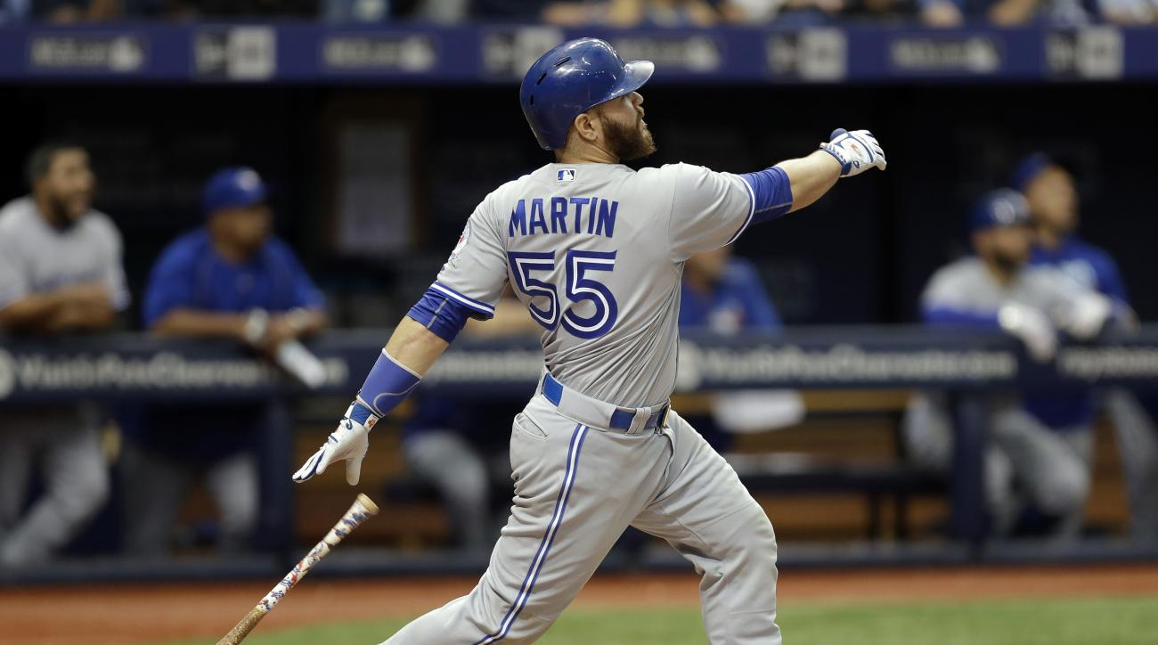 Toronto Blue Jays' Russell Martin watches his two-run home run off Tampa Bay Rays relief pitcher Kevin Jepsen during the eighth inning of a baseball game, Sunday, Sept. 4, 2016, in St. Petersburg, Fla. (AP Photo/Chris O'Meara)
