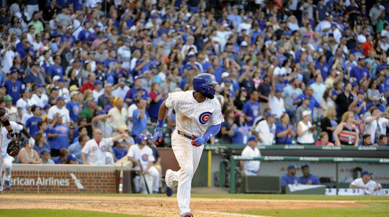 Chicago Cubs' Jason Heyward runs to first base after hitting a winning single against the San Francisco Giants during the 13th inning of a baseball game, Sunday, Sept. 4, 2016, in Chicago. (AP Photo/David Banks)