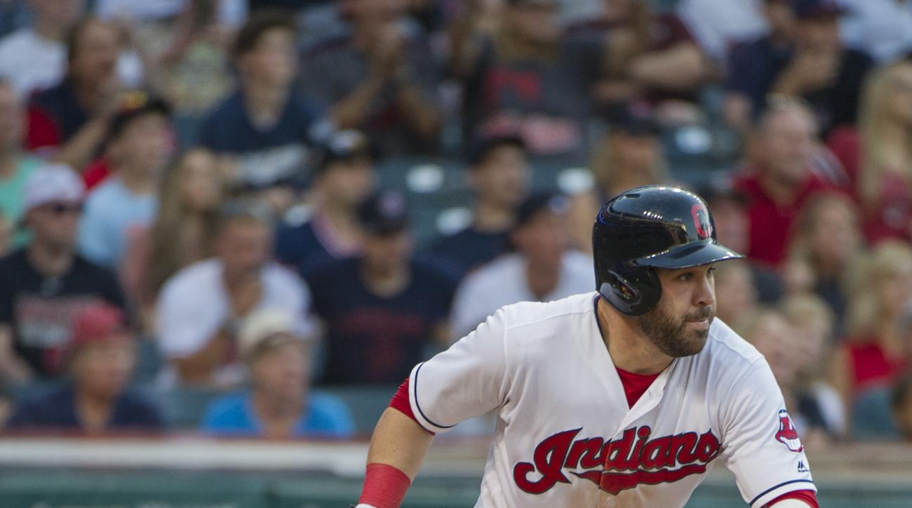 Cleveland Indians' Jason Kipnis runs to first base after hitting a two-run single during the seventh inning of a baseball game in Cleveland, Sunday, Sept. 4, 2016. (AP Photo/Phil Long)