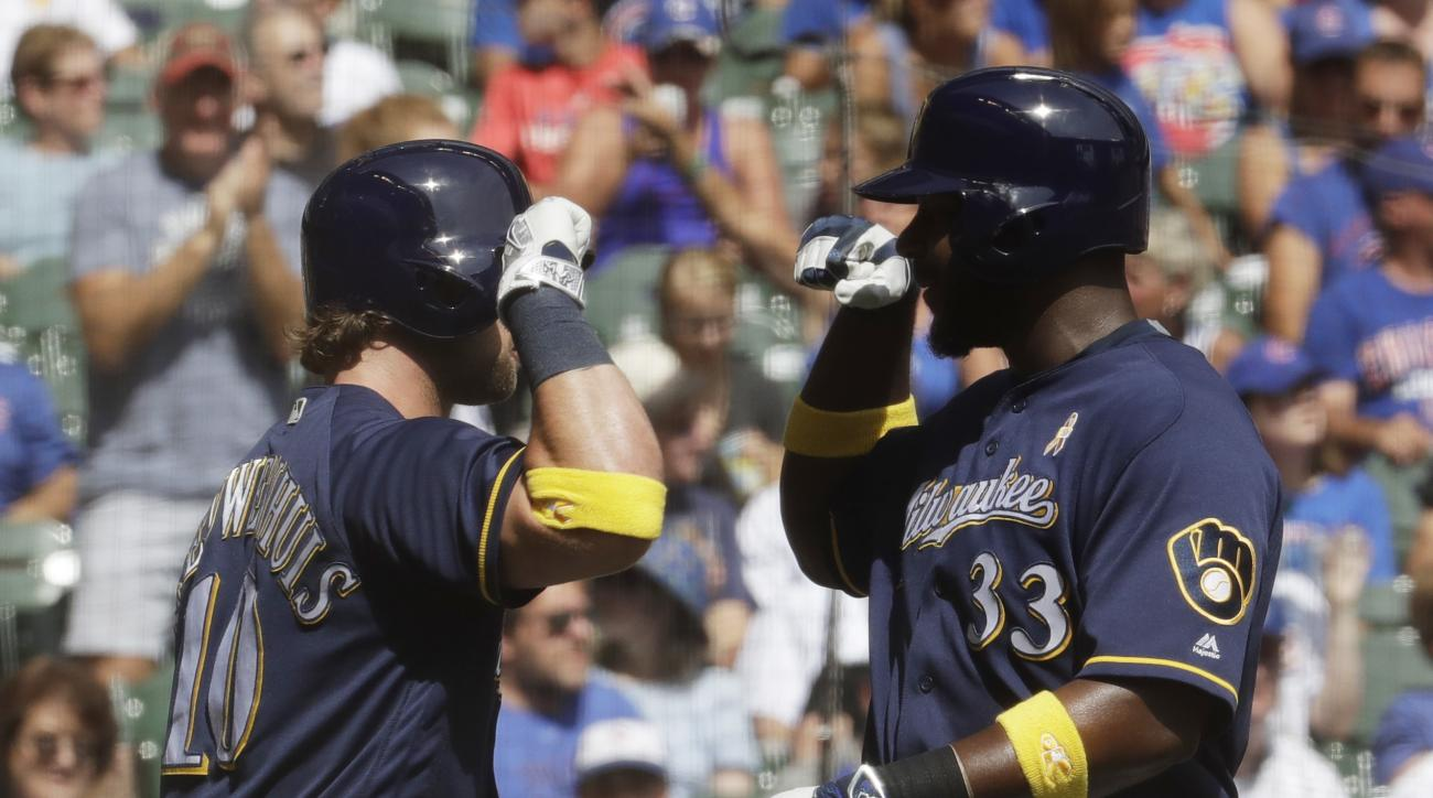 Milwaukee Brewers' Chris Carter is congratulated by Kirk Nieuwenhuis (10) after hitting a home run during the second inning of a baseball game against the Chicago Cubs Monday, Sept. 5, 2016, in Milwaukee. (AP Photo/Morry Gash)