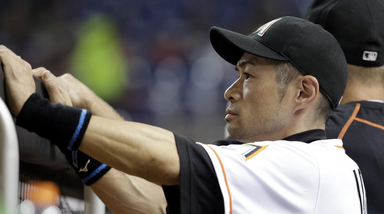 Miami Marlins' Ichiro Suzuki, of Japan, watches from the dugout during the sixth inning of a baseball game against the Philadelphia Phillies, Tuesday, Sept. 6, 2016, in Miami. (AP Photo/Lynne Sladky)