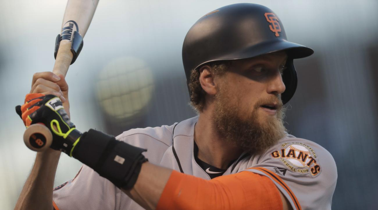 San Francisco Giants' Hunter Pence warms up in the on-deck circle in the first inning of a baseball game against the Colorado Rockies, Tuesday, Sept. 6, 2016, in Denver. (AP Photo/David Zalubowski)