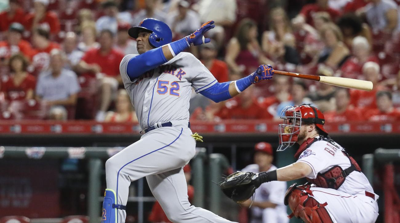 New York Mets' Yoenis Cespedes follows through on a two-run home run off Cincinnati Reds relief pitcher Michael Lorenzen during the seventh inning of a baseball game, Tuesday, Sept. 6, 2016, in Cincinnati. (AP Photo/John Minchillo)