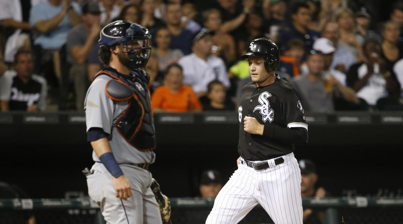 Chicago White Sox's Jason Coats scores past Detroit Tigers catcher Jarrod Saltalamacchia, off a single by Omar Narvaez, during the fifth inning of a baseball game Tuesday, Sept. 6, 2016, in Chicago. (AP Photo/Charles Rex Arbogast)