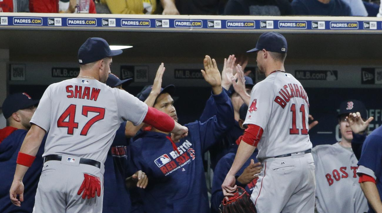Boston Red Sox starting pitcher Clay Buchholz is congratulated at the dugout after coming out of the baseball game against the San Diego Padres during the seventh inning Tuesday, Sept. 6, 2016, in San Diego. Buchholz went six and two-thirds innings and al