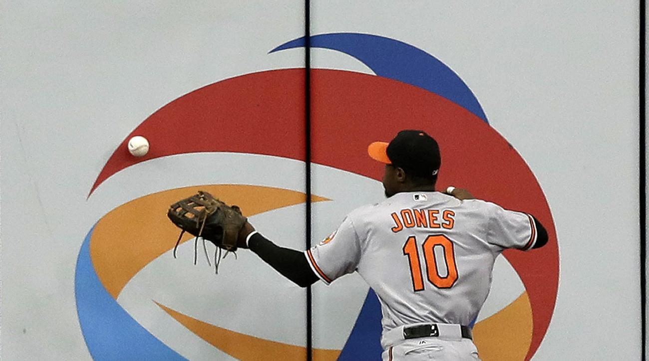 Baltimore Orioles center fielder Adam Jones (10) plays an RBI double by Tampa Bay Rays' Corey Dickerson off the wall during the seventh inning of a baseball game Wednesday, Sept. 7, 2016, in St. Petersburg, Fla. (AP Photo/Chris O'Meara)