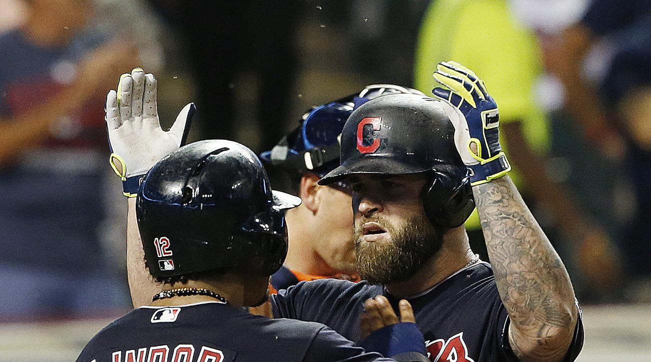 Cleveland Indians' Mike Napoli, right, gets congratulations from Francisco Lindor after hitting a two-run home run off Houston Astros starting pitcher Doug Fister during the fifth inning of a baseball game Wednesday, Sept. 7, 2016, in Cleveland. (AP Photo