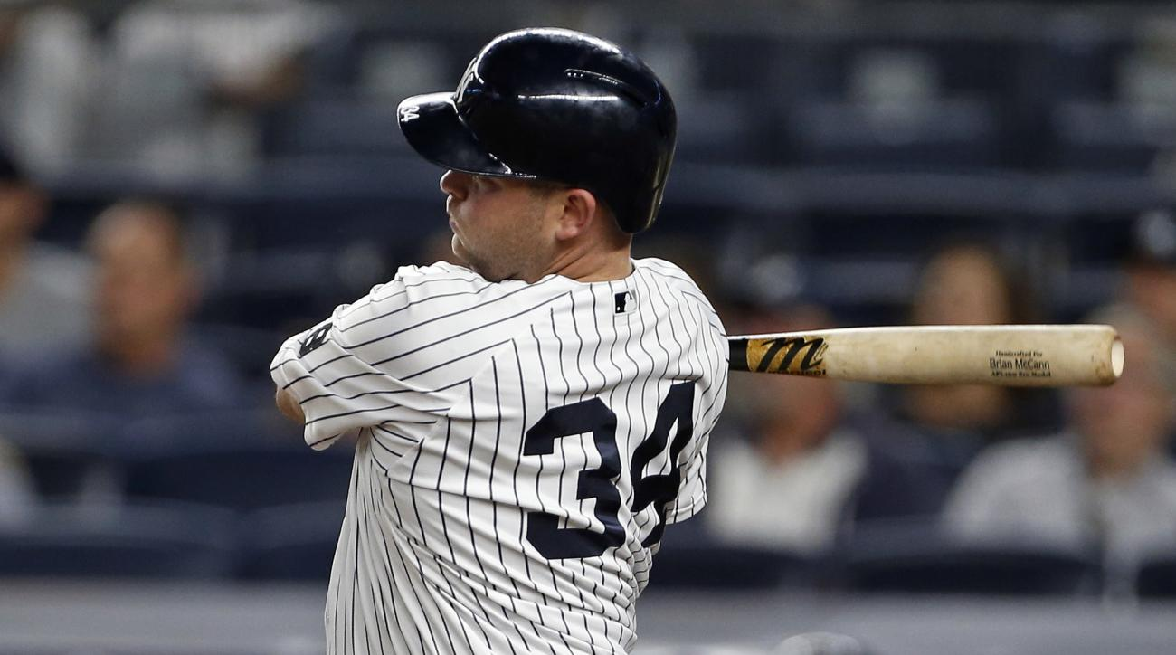 New York Yankees designated hitter Brian McCann follows through on an RBI single during the third inning of a baseball game against the Toronto Blue Jays on Wednesday, Sept. 7, 2016, in New York. (AP Photo/Adam Hunger)