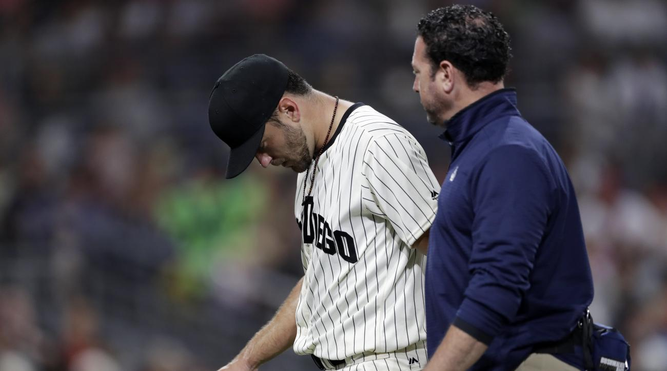 San Diego Padres starting pitcher Jarred Cosart walks off the field with a trainer after injuring himself during the fourth inning of a baseball game against the Boston Red Sox, Wednesday, Sept. 7, 2016, in San Diego. (AP Photo/Gregory Bull)