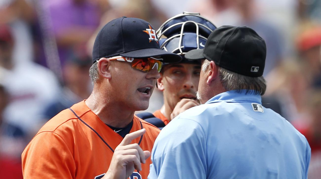 Houston Astros manager A.J. Hinch (14) argues a call with home plate umpire Jim Joyce as catcher Jason Castro looks on after two runs scored on a wild pitch against the Cleveland Indians during the third inning of a baseball game Thursday, Sept. 8, 2016,