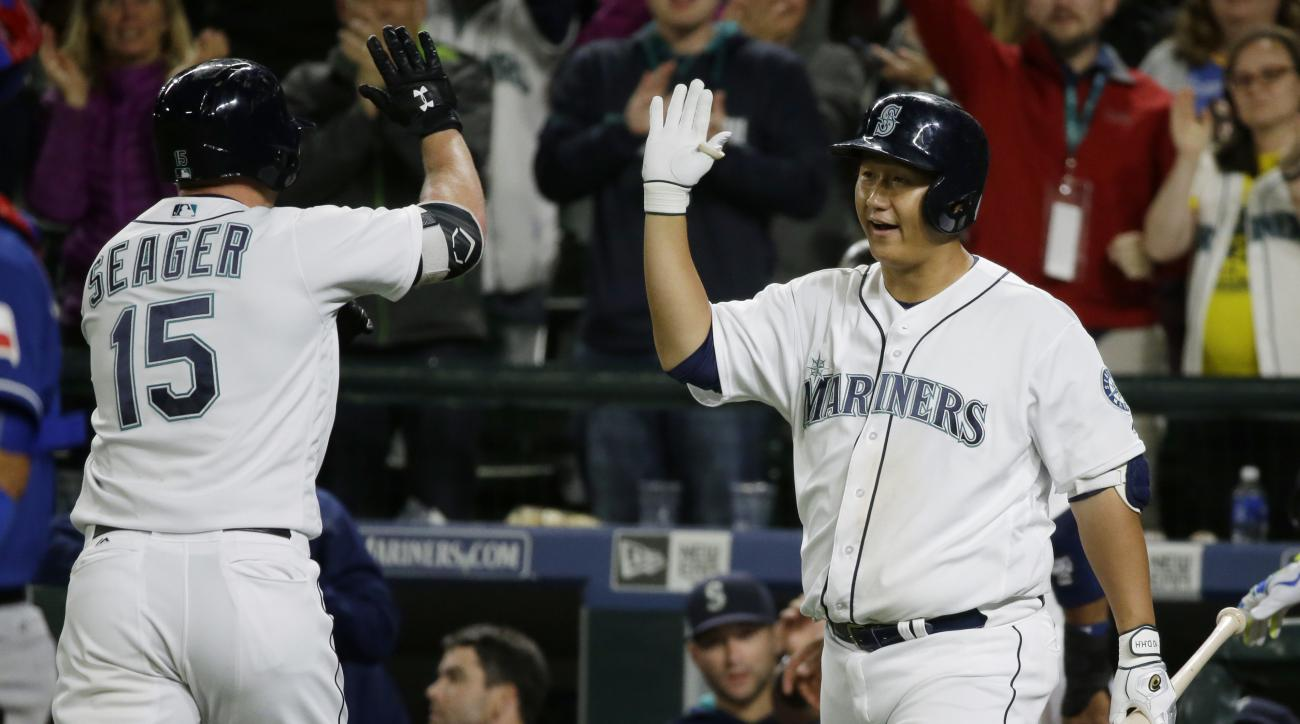 Seattle Mariners' Kyle Seager (15) is greeted by Dae-Ho Lee, right, after Seager hit a two-run home run during the seventh inning of a baseball game against the Texas Rangers, Thursday, Sept. 8, 2016, in Seattle. (AP Photo/Ted S. Warren)