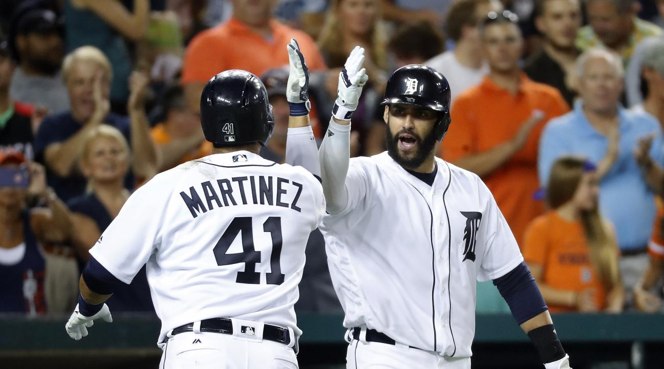 Detroit Tigers' Victor Martinez (41) celebrates his solo home run against the Baltimore Orioles with J.D. Martinez during the eighth inning of a baseball game in Detroit, Friday, Sept. 9, 2016. (AP Photo/Paul Sancya)
