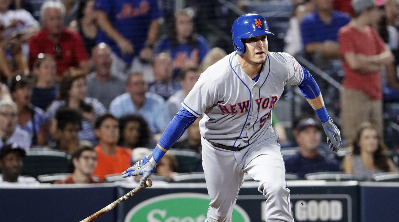 New York Mets' Kelly Johnson watches his RBI double during the eighth inning of a baseball game against the Atlanta Braves in Atlanta, Friday, Sept. 9, 2016. (AP Photo/David Goldman)