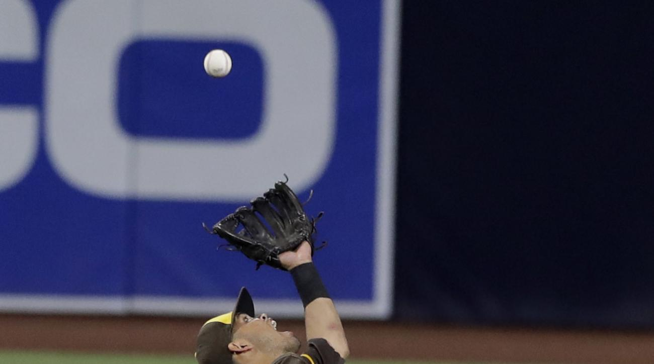 San Diego Padres shortstop Luis Sardinas makes an over-the-shoulder catch for the out on Colorado Rockies' Charlie Blackmon during the seventh inning of a baseball game Friday, Sept. 9, 2016, in San Diego. (AP Photo/Gregory Bull)