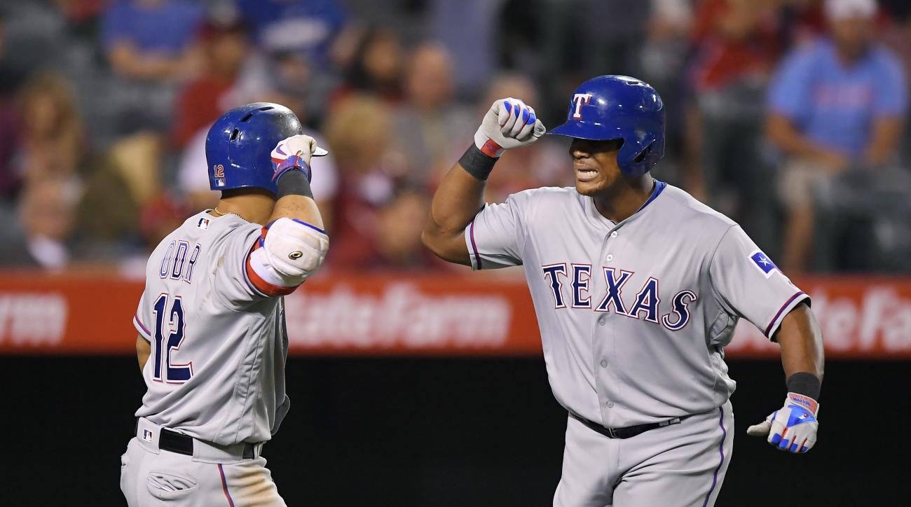 Texas Rangers' Adrian Beltre, right, is congratulated by Rougned Odor after hitting a solo home run during the eighth inning of a baseball game against the Los Angeles Angels, Friday, Sept. 9, 2016, in Anaheim, Calif. (AP Photo/Mark J. Terrill)