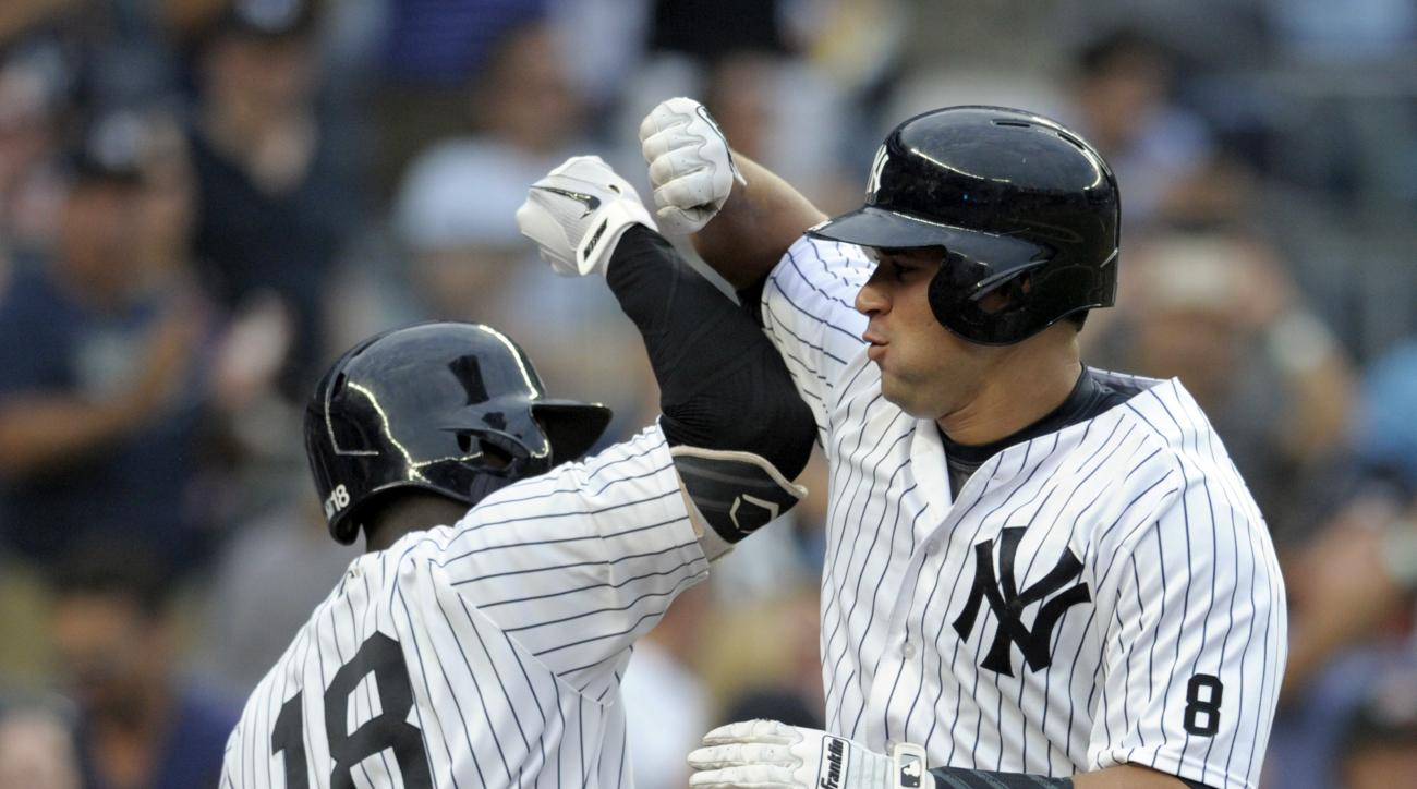 New York Yankees' Gary Sanchez, right, celebrates with Didi Gegorius after hitting a home run during the sixth inning of a baseball game against the Tampa Bay Rays Saturday, Sept. 10, 2016, at Yankee Stadium in New York. (AP Photo/Bill Kostroun)
