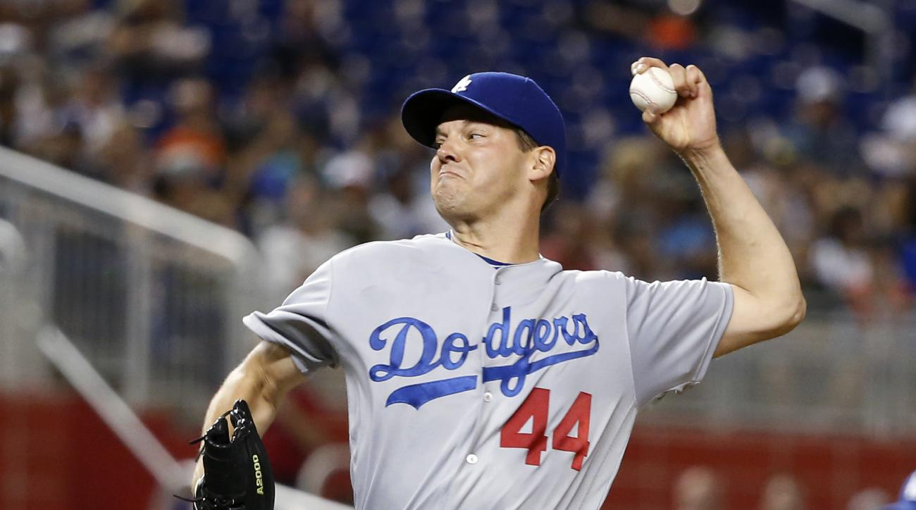 Los Angeles Dodgers' Rich Hill delivers a pitch during the first inning of a baseball game against the Miami Marlins, Saturday, Sept. 10, 2016, in Miami. (AP Photo/Wilfredo Lee)