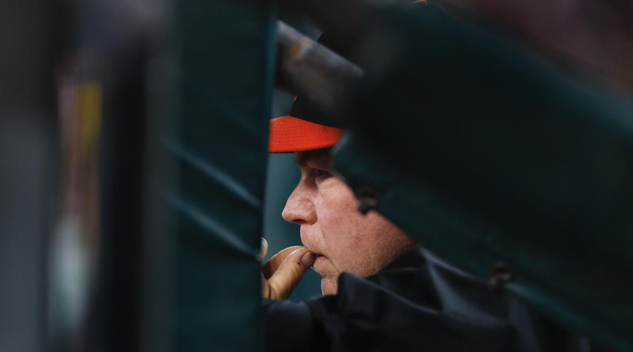 Baltimore Orioles manager Buck Showalter watches from the dugout against the Detroit Tigers in the sixth inning of a baseball game in Detroit, Saturday, Sept. 10, 2016. (AP Photo/Paul Sancya)