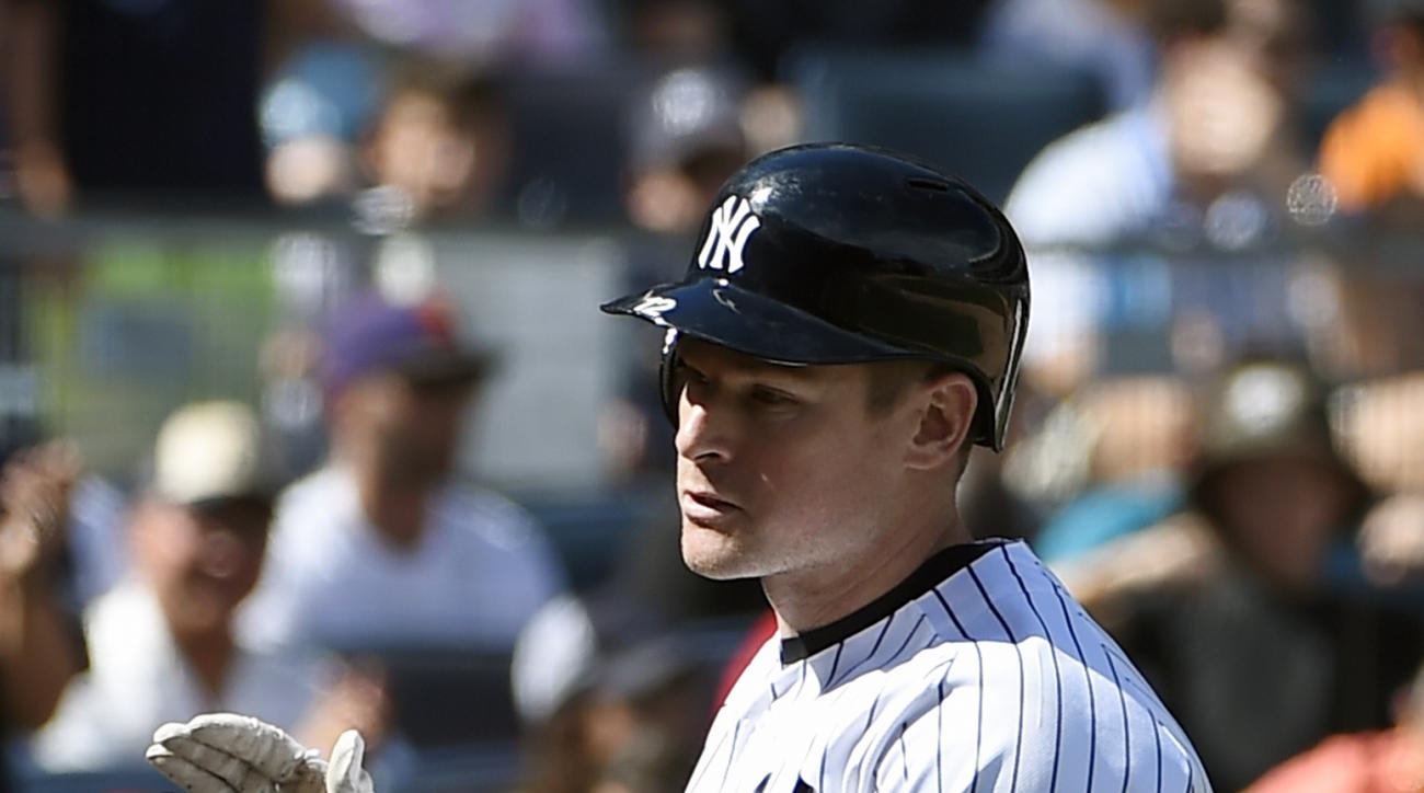 New York Yankees' Chase Headley claps his hands as he crosses home plate after hitting a solo home run against the Tampa Bay Rays in the fifth inning of a baseball game, Sunday, Sept. 11, 2016, in New York. (AP Photo/Kathy Kmonicek)