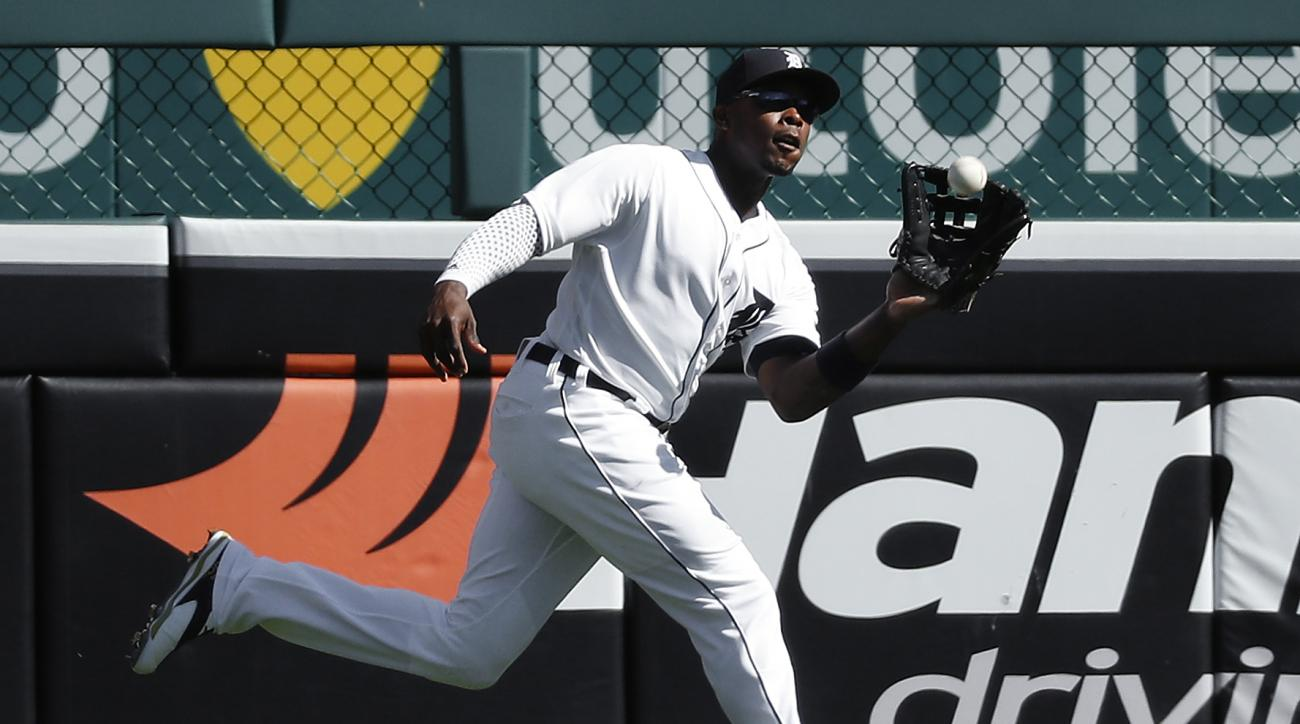 Detroit Tigers left fielder Justin Upton catches a Baltimore Orioles' Manny Machado fly ball in the seventh inning of a baseball game in Detroit, Sunday, Sept. 11, 2016. (AP Photo/Paul Sancya)