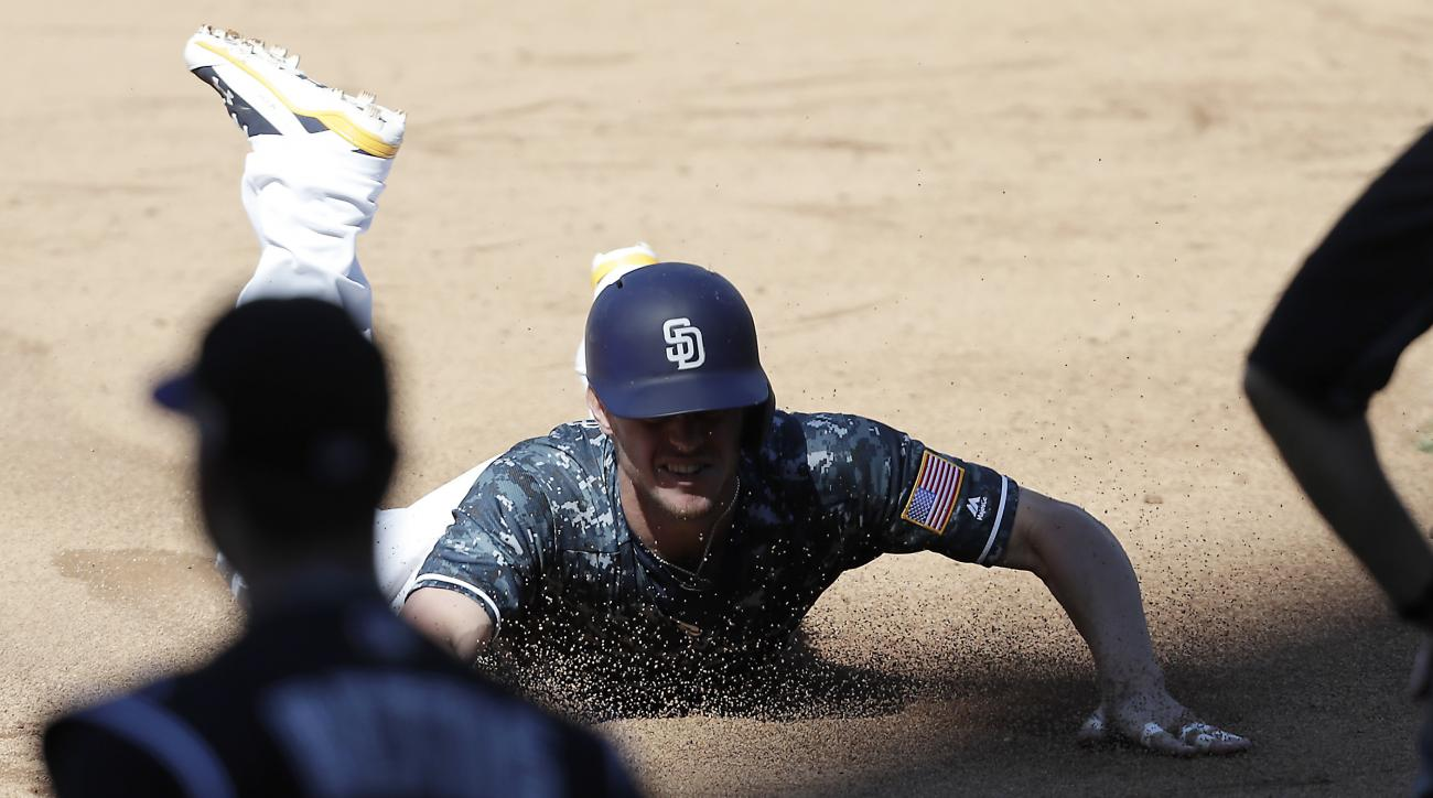 San Diego Padres' Wil Myers slides into third base after hitting a triple allowing Travis Jankowski to score a run against the Colorado Rockies during the sixth inning of a baseball game, Sunday, Sept. 11, 2016, in San Diego. (AP Photo/Ryan Kang)