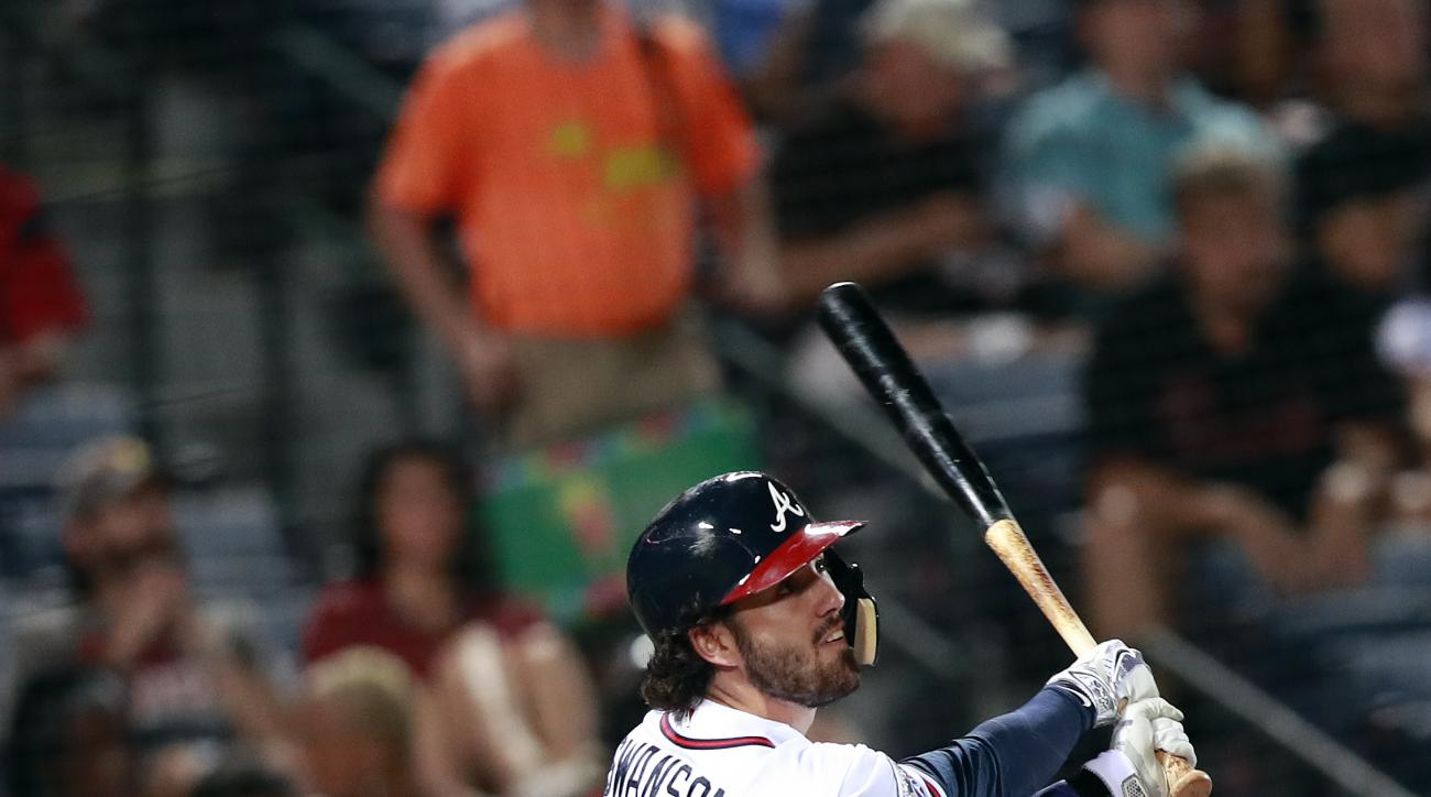 Atlanta Braves' Dansby Swanson drives in a run with a sacrifice fly in the third inning of a baseball game against the Miami Marlins in Atlanta, on Monday Sept. 12, 2106. (AP Photo/John Bazemore)